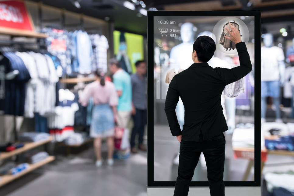 Man using digital signage solutions